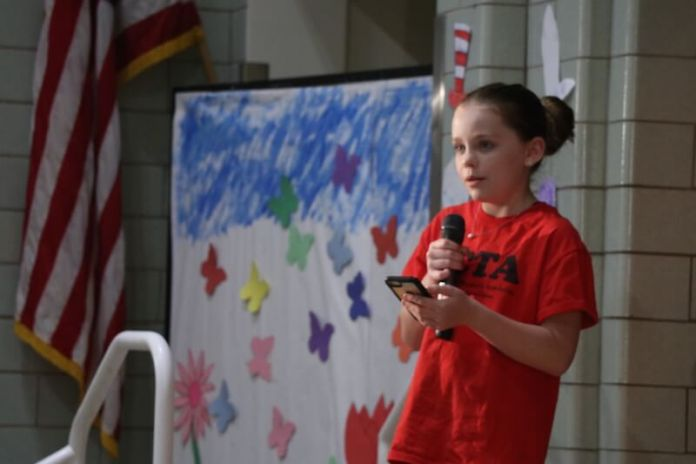 A Denver Public Schools seventh-grader reads to a community gathering on May 29, 2019 from a last will and testament she wrote in her cellphone notes after a recent lockdown at her middle school. (Photo by Grace Carson)