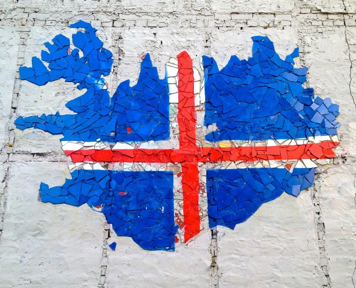 In a Reykjavik back alley, a guerilla artist created this wall mosaic with bits of chipped plaster and other recycled material.