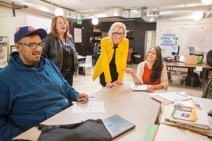 Denver Mayoral candidate Jamie Giellis, third from left, chats with her staff at their campaign headquarters in Denver, Colo., Thursday, May 23, 2019. (Photo by Bear Gutierrez)
