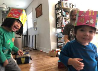 Self-isolating Grandpa walks in on the action with grandsons Lalo and Ricky. I don't know where the hats came from, but I wished I had one, too. (Photo by Angie Littwin)