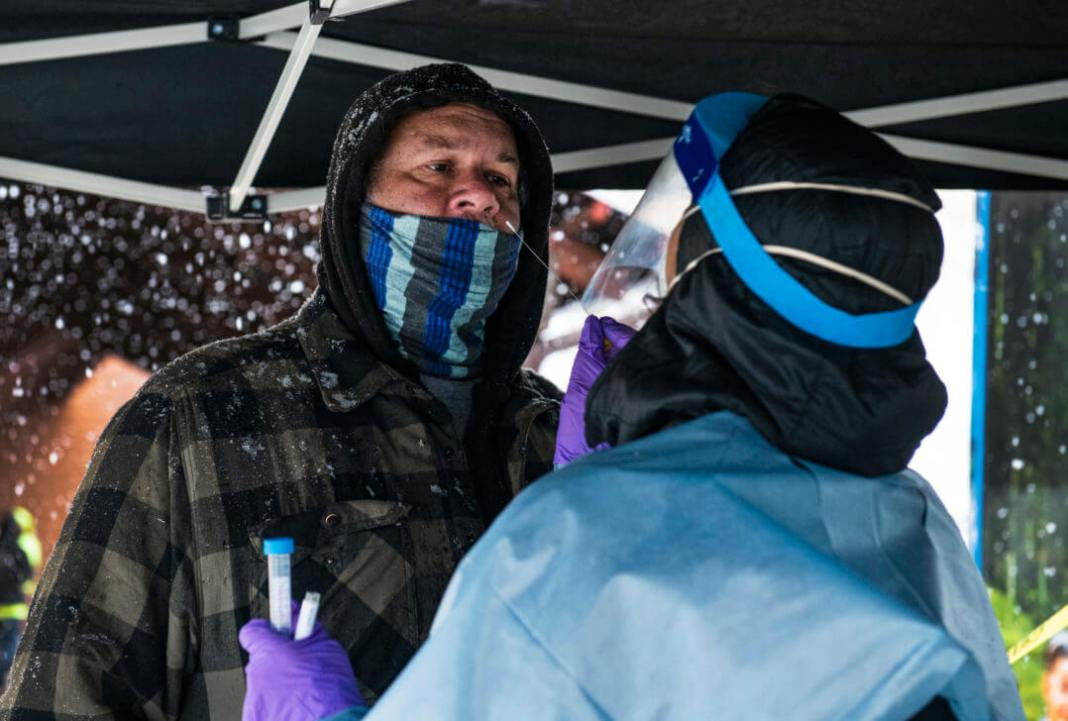 David Parker gets tested for COVID-19 at the MIRA bus in El Jebel on Thursday, April 16, 2020. Parker explained that the week before him and his family, who are now quarantined together, were transmitted through five different international airports. (Kelsey Brunner/The Aspen Times)