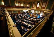 Members of the Colorado House of Representatives toil as lawmakers try to wrap up the 2020 session in the State Capitol Monday, June 15, 2020, in Denver.