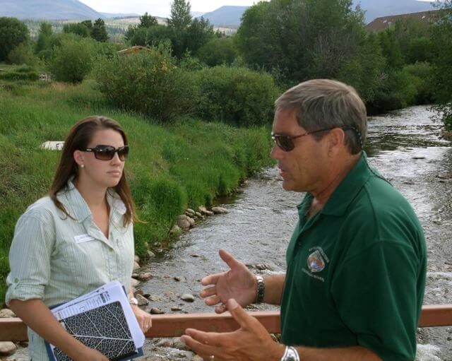 Grand County resident Kirk Klancke (R) and Trout Unlimitie's Erica Stock discusss how taking water from the Fraser River affects the local economy and environment.