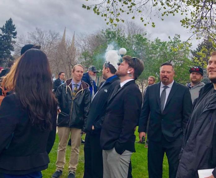 People vaping outside the Colorado Capitol on Wednesday, May 1, 2019 as lawmakers debate a bill that would increase taxes on nicotine products to help expand state-funded preschool programs. (Photo by Alex Burness)