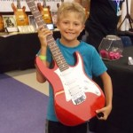 Spencer with red guitar