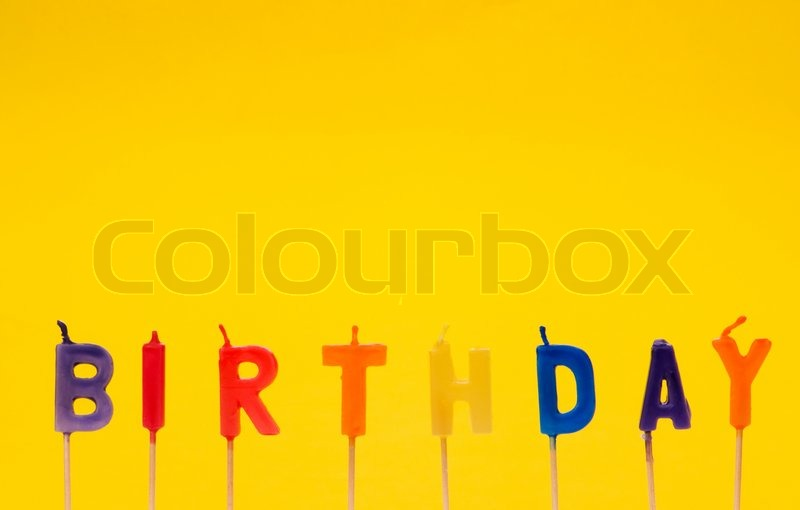Happy Birthday Isolated On The Yellow Background Stock