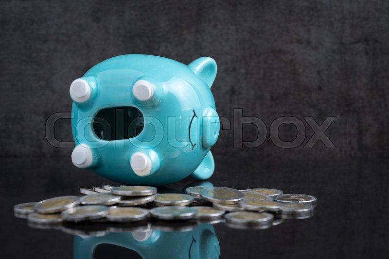 Saving Money Problem With Empty Piggy Bank Lay On Dark
