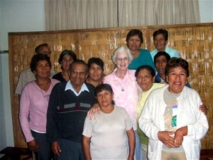 The Parish Mission Team surround their long-time friend, Hermana Bridie