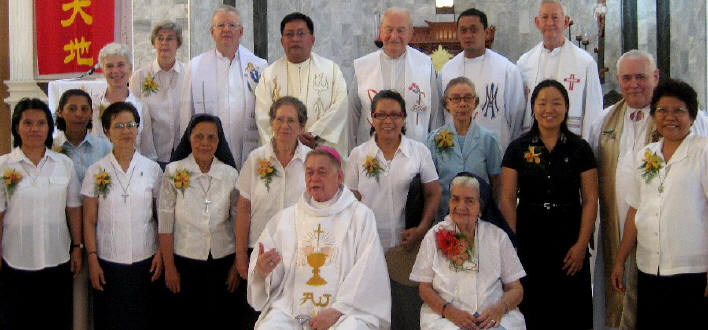 Sister Regina with Archbishop Dosado, Columban sisters and priests.