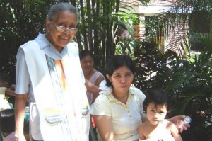 Sister Letty, former Principal of Malate Catholic School, with a mother and little daughter