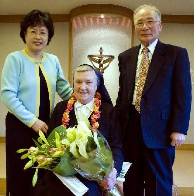Sister Philomena with John Kim and his daugher, Cecilia.