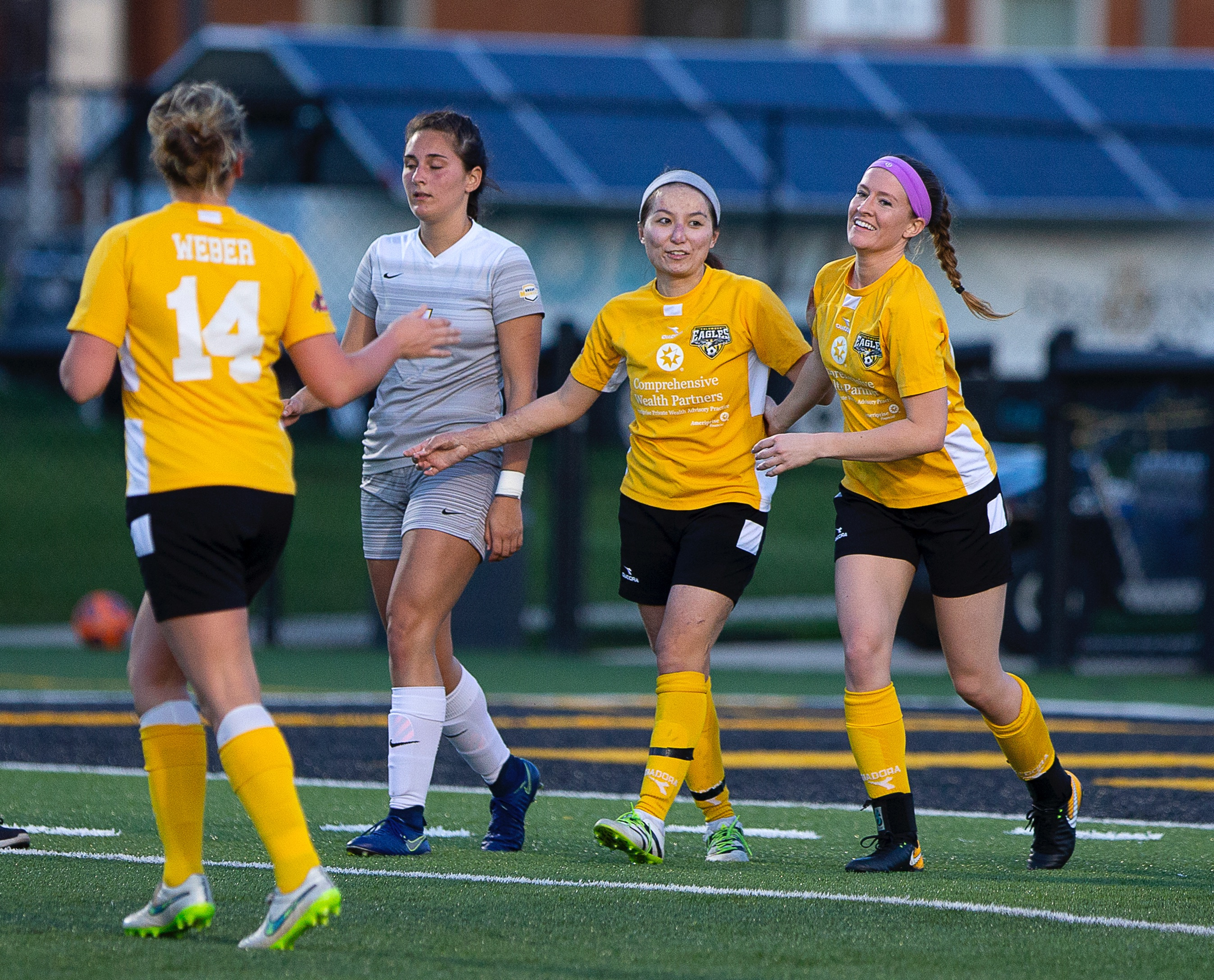 Rachel MacLeod (right) and Lisa Nouanesengsy celebrate MacLeod's goal against Ohio Dominican University | Daniel Herlensky