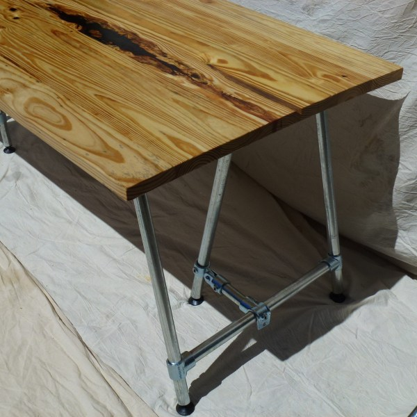 A resin filled reclaimed timber table top