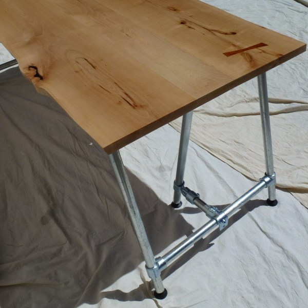 Beech Waney Edge Top complete with Iroko Butterfly Joint on a Les Alpes Trestle