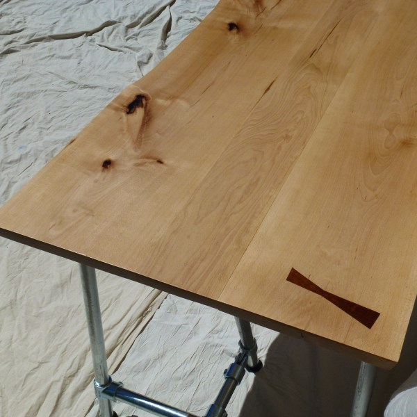 Three wide boards comprise this Beech waney edge table top