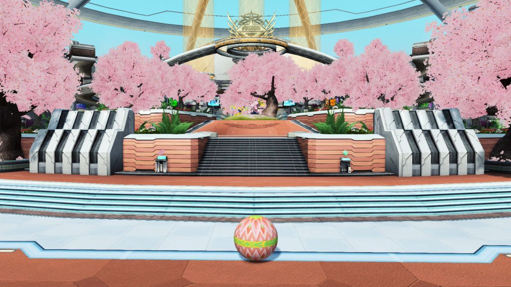 A large, open-air avenue lined with blooming cherry blossoms. A pink robot can be seen in the distance.
