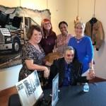 Linda Crissey with staff and Burt Reynolds