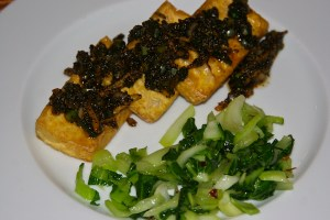 Photo of black pepper tofu with a side of bok choy