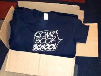 Comic Book School shirts in box