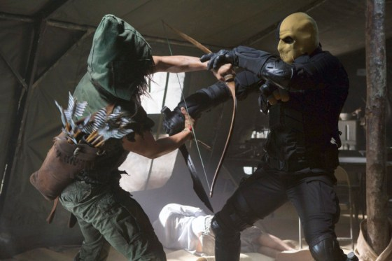 Green Arrow fights hooded figure