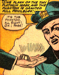 Le signe de reconnaissance du Phantom Detective : Un petit masque de platine...