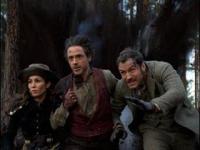 Robert Downey Jr. & Jude Law as Sherlock Holmes and Dr. Watson