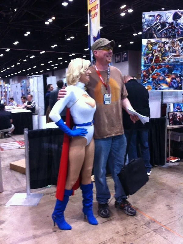 power Girl poses with pal.