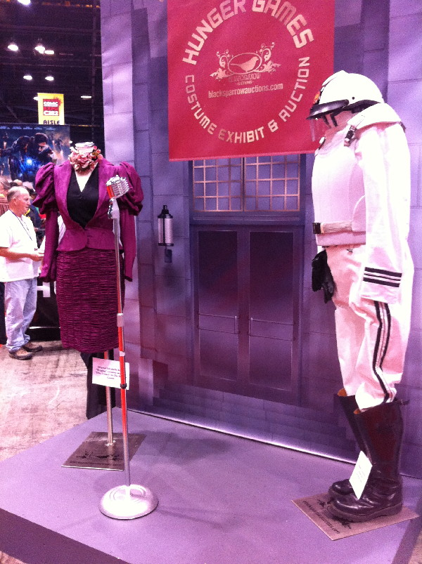 This booth has a display of cstumes from The HUnger Games and raised money for a food bank.
