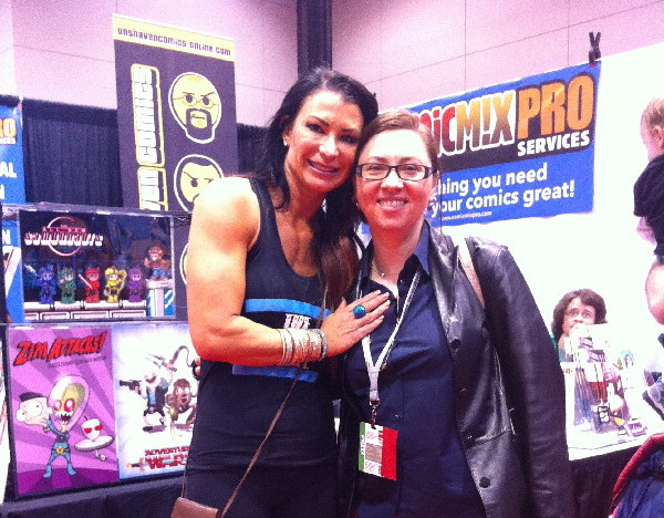 "Continuing the bicep trend, I found Lisa Marie Varon, aka""Tara"" promoting her restaurant at the ComicMix booth. Whut? It was that kind of crazy world."