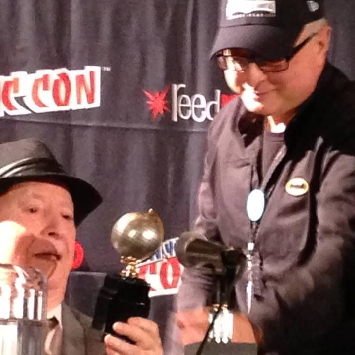 Michael Uslan presenting the Eisner to Irwin Hasen.