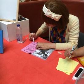 Rokudenashiko signs and sketches.