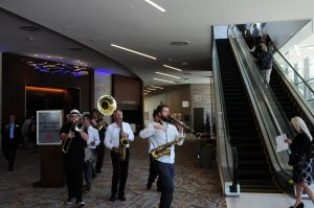 Band Plays the guests and press into the new building.