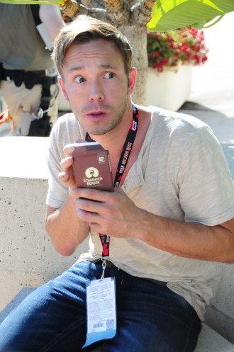 Author and Artist Ben Hatke, protecting his bar of chocolate.