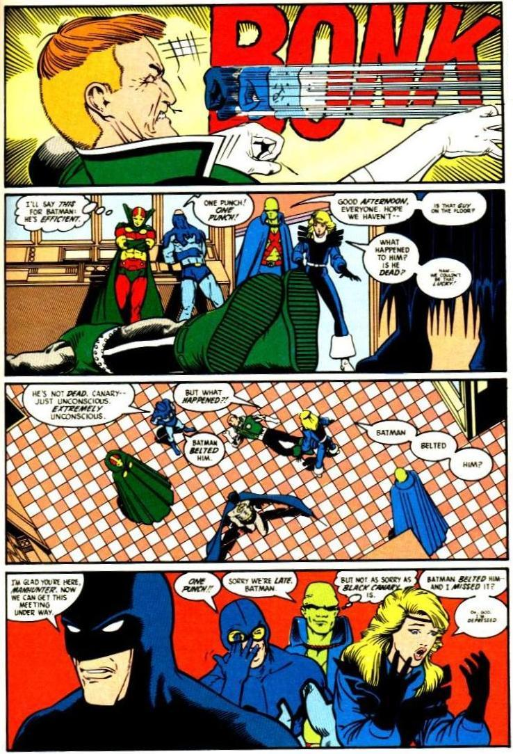 The classic Batman laying out Guy Gardner with one punch scene from Justice League #1