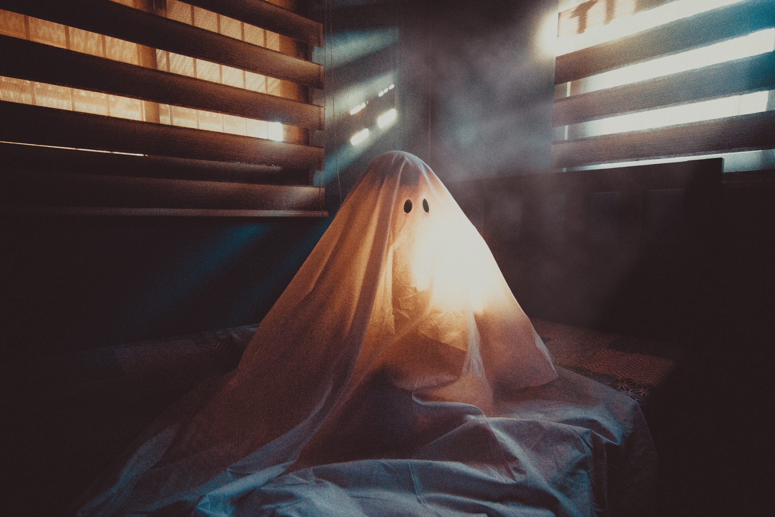 A spooky ghost all alone on Halloween