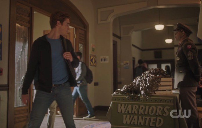 Archie breaking his neck looking back at the army recruitment table in Riverdale High
