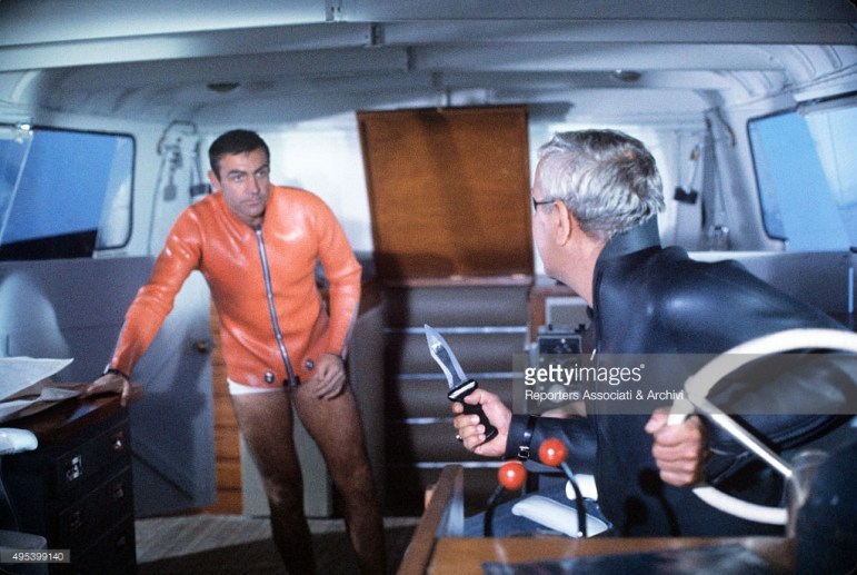 Scottish actor Sean Connery arguing with Italian actor Adolfo Celi in the film Thunderball. 1965