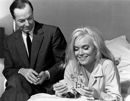 ***COLLECT IMAGE PLEASE CONTACT Graham Rye editor@007magazine.co.uk for further use *** MUST Credit www.007magazine.com Bond film Goldfinger (1964). Scene from the film Goldfinger with Sean Connery and Jill Masterson played by Shirley Eaton playing cards in the Fontainebleau Hotel bedroom, with director Guy Hamilton