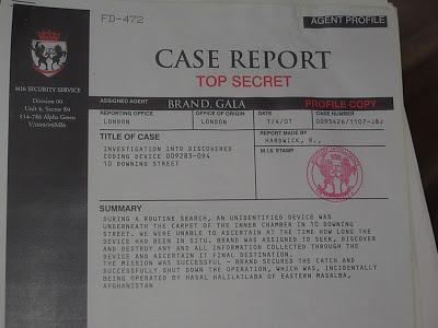 Document que M tient à l'écran... sous le nom de Gala Brand.