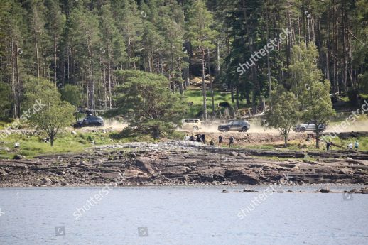 Mandatory Credit: Photo by Peter Jolly/Shutterstock (10337523c) Film crew prepare to shoot a car chase scene for the new James Bond Movie on the Ardverikie Estate. James Bond film set, Aviemore, Scotland, UK - 15 Jul 2019 Photo taken from the public road on the other side of the Loch.