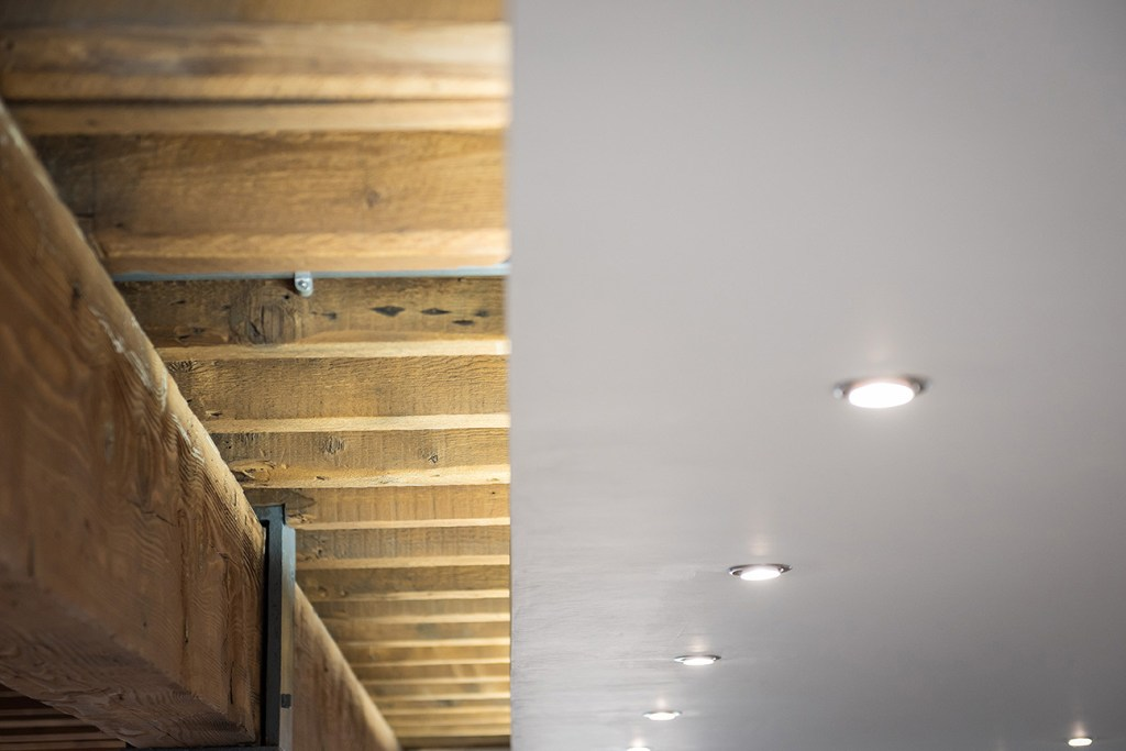 exposed timber joists and part plastered ceiling
