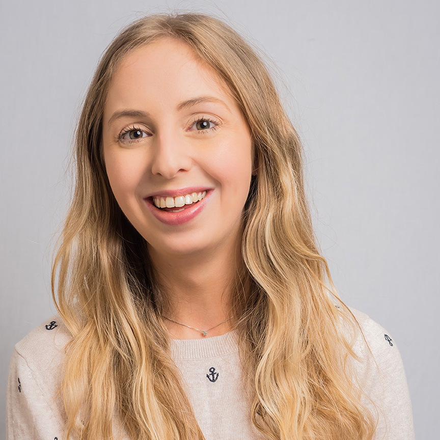 business headshot photo of young woman smiling to camera