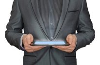 man in a gray suit holding a tablet