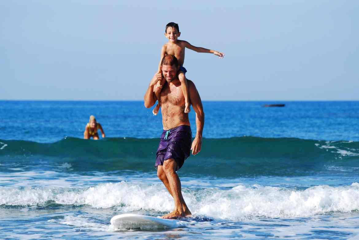 dad and son on surfboard