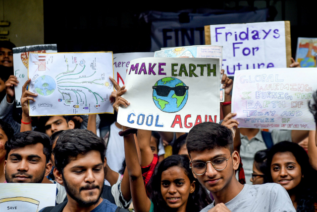 College students hold posters while participating in a 'Fridays for Future' climate strike to protest against governments' inaction towards climate breakdown and environmental pollution in Mumbai on September 20, 2019. (Photo by Indranil Mukherjee/AFP/Getty Images)