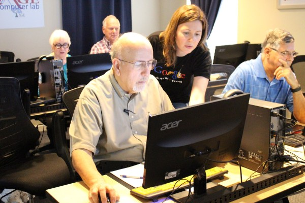 Google volunteer assisting learner at AGE.