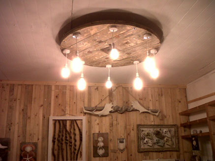 A ceiling light at a wooden art display at the Brighton Wood Store