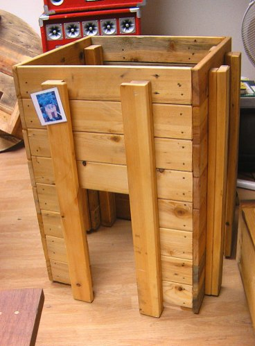 A wooden compost bin - simple and environmentally friendly
