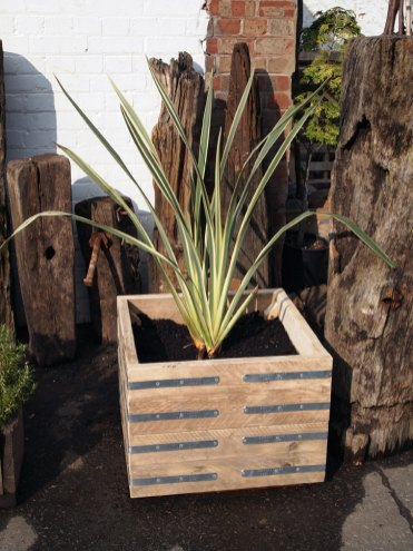 Wooden planters help a garden maintain a natural look