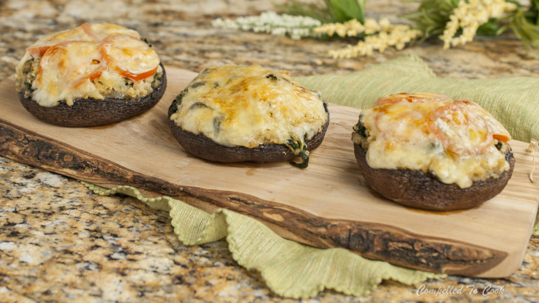 Spinach and Quinoa Stuffed Portabella Mushrooms are a tasty vegetarian dish.